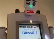 A robot priest named BlessU-2 beams lights from its hands and is giving 'auto-blessings' in the same German city where Martin Luther launched the Protestant Reformation.